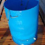 A nursery silo (55 gallon drum) with a micromesh screen bottom.